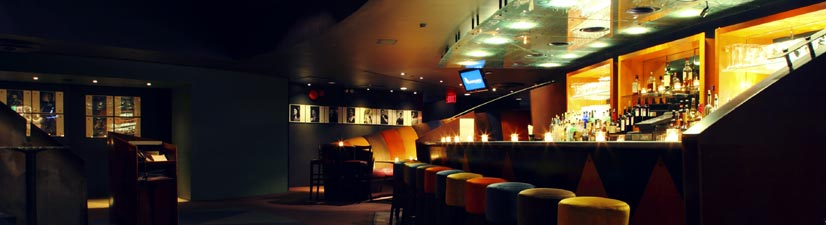 rent a manhattan comedy club for corporate holiday party - fun and colorful setup