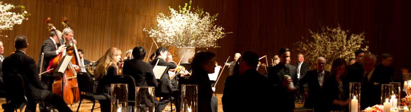 orchestra performing at gala event in hell's kitchen concert venue