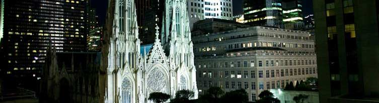 rockefeller center nyc event spaces - view of st. patrick's cathedral and skyscrapers at night